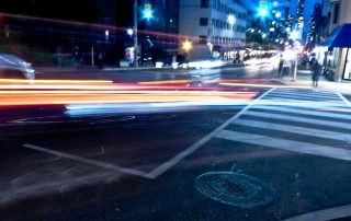 Image of cars driving by at night